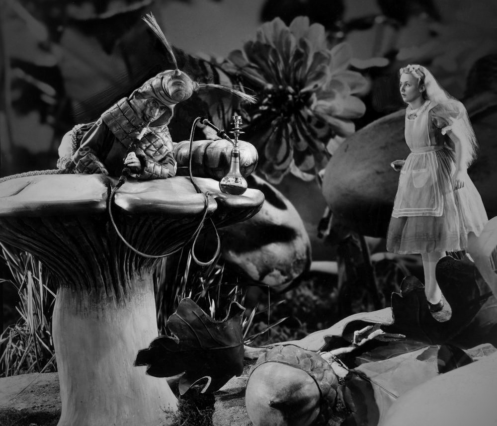 Alice (Charlotte Henry) meets The Caterpillar (Ned Sparks) in Alice in Wonderland (1933)