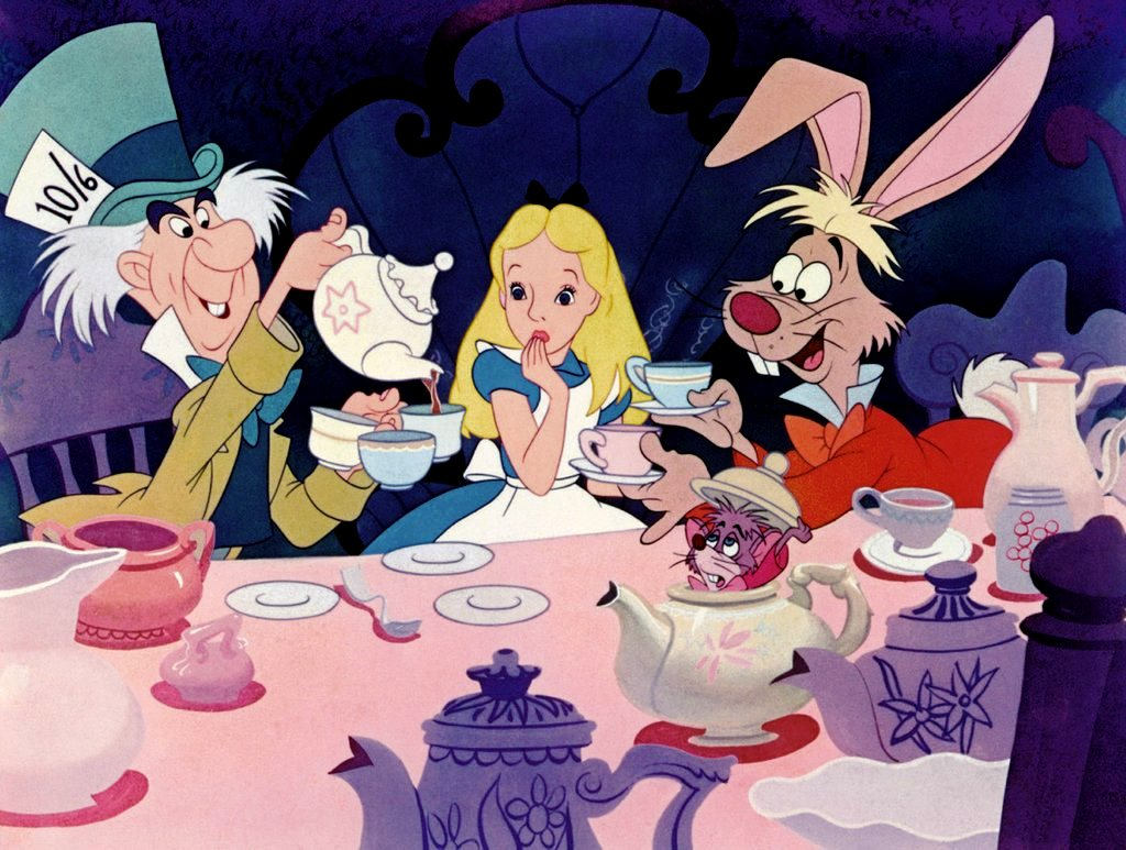 The Mad Hatter's Tea Party with (l to r) The Had Matter, Alice, The White Rabbit (and with the Dormouse hiding in the tea pot) in Alice in Wonderland (1951)