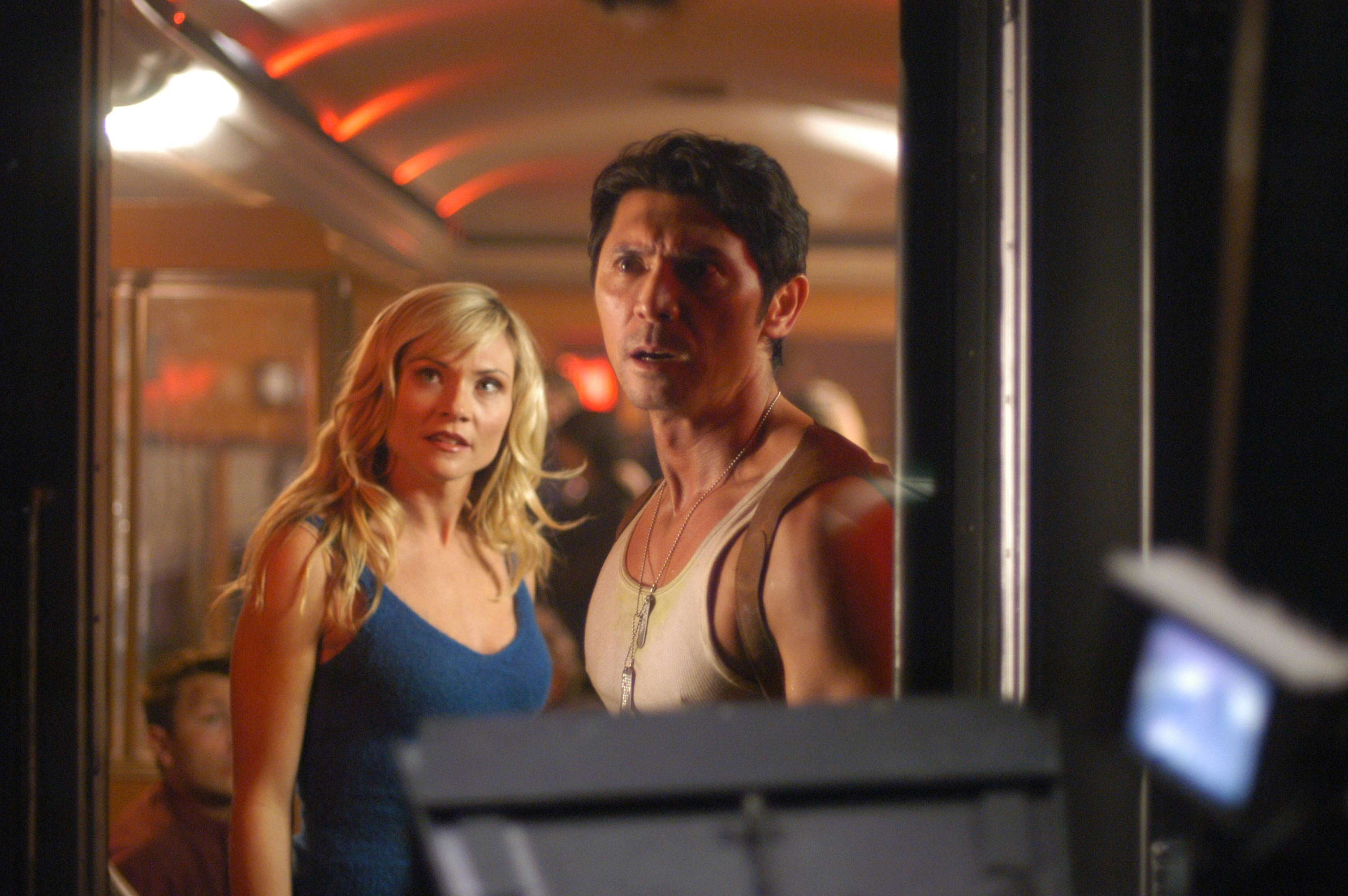Amy Locane and Lou Diamond Phillips in Alien Express (2005)