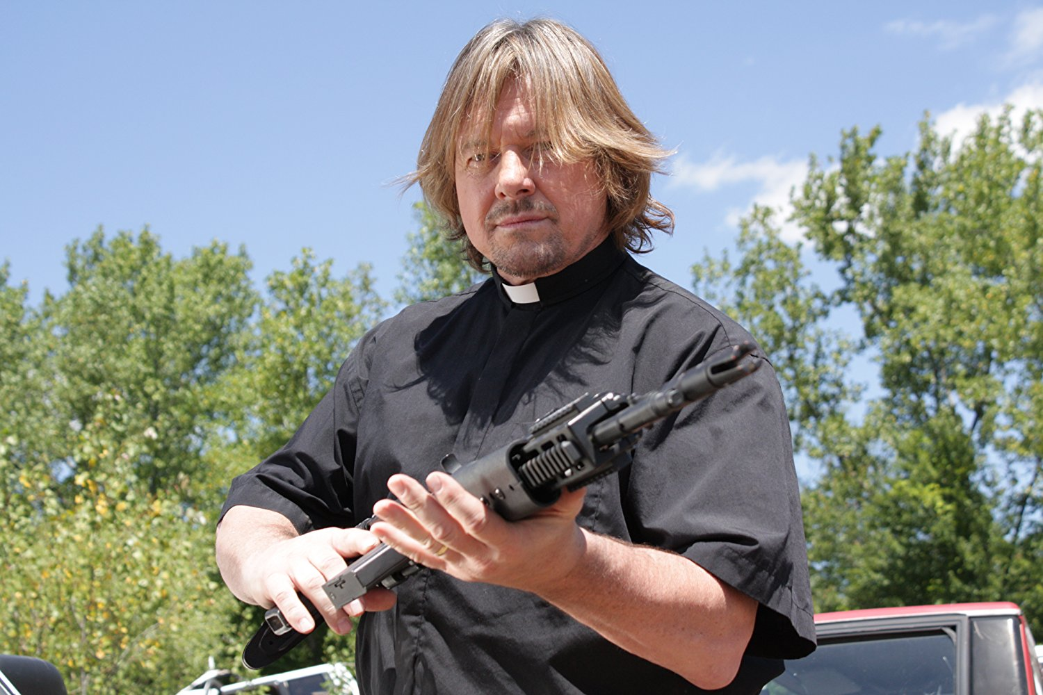 Roddy Piper as Father Melluzzo in Alien Opponent (2011)