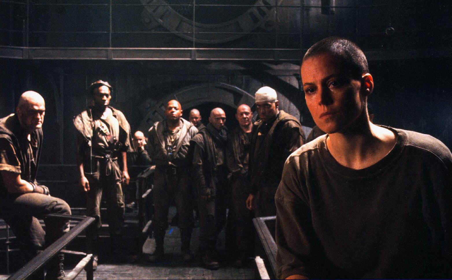 Ripley (Sigourney Weaver) (front right) and the prisoners of Fiorina 161 in Alien3 (1992)