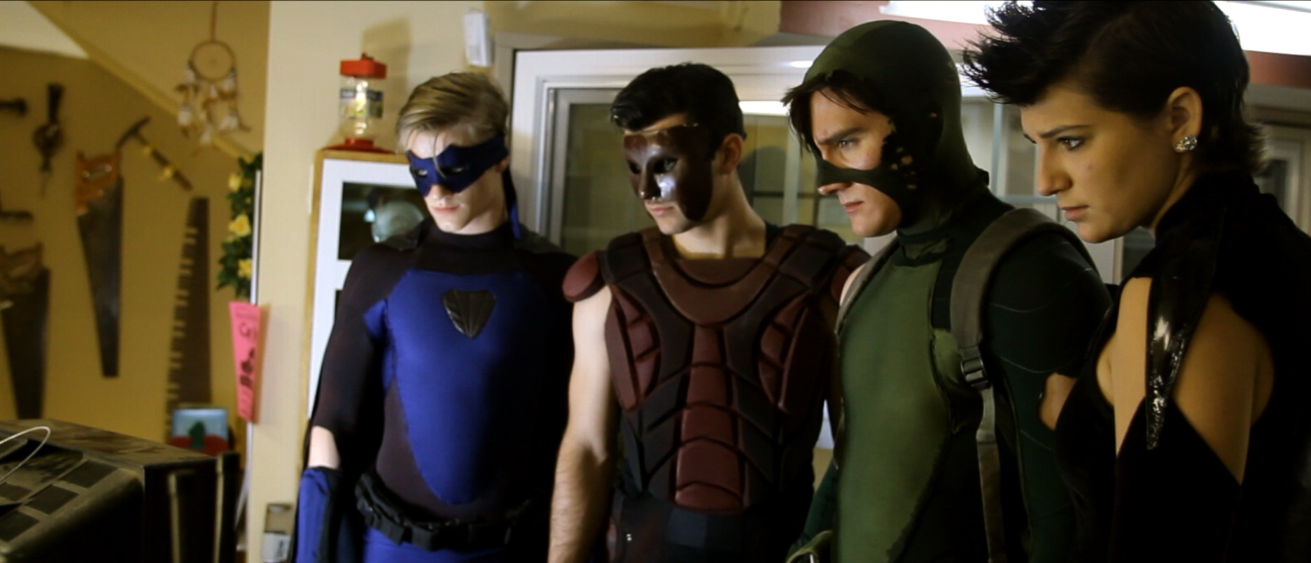 The superheroes - Cutthroat (Lucas Till), The Wall (Lee Valmassy), Charge (Jason Trost) and Shadow (Sophie Merkley) in All Superheroes Must Die (2011)