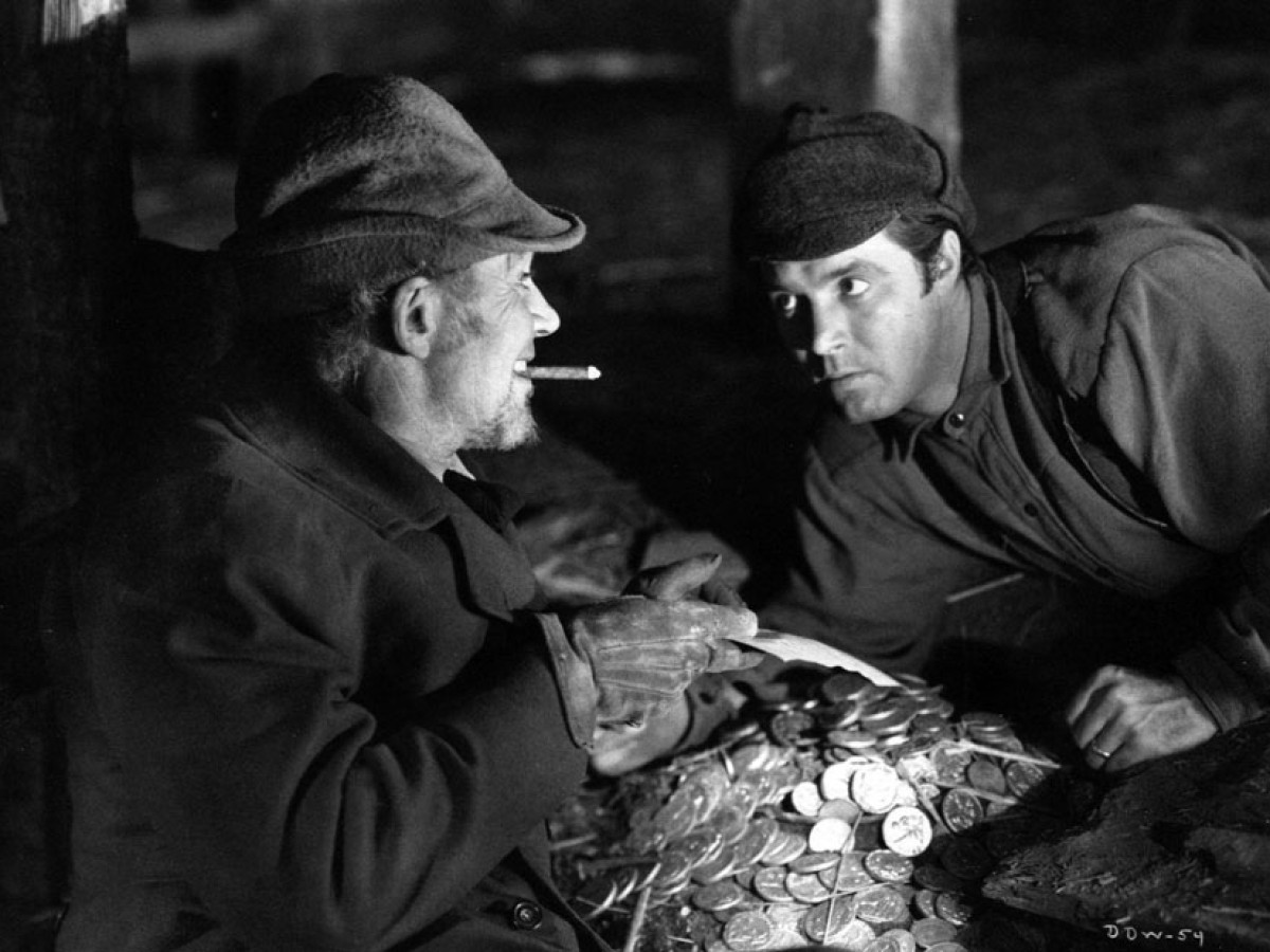 (l to r) Mr Scratch (Walter Huston) tempts Jabez Stone (James Craig) in All That Money Can Buy (1941)