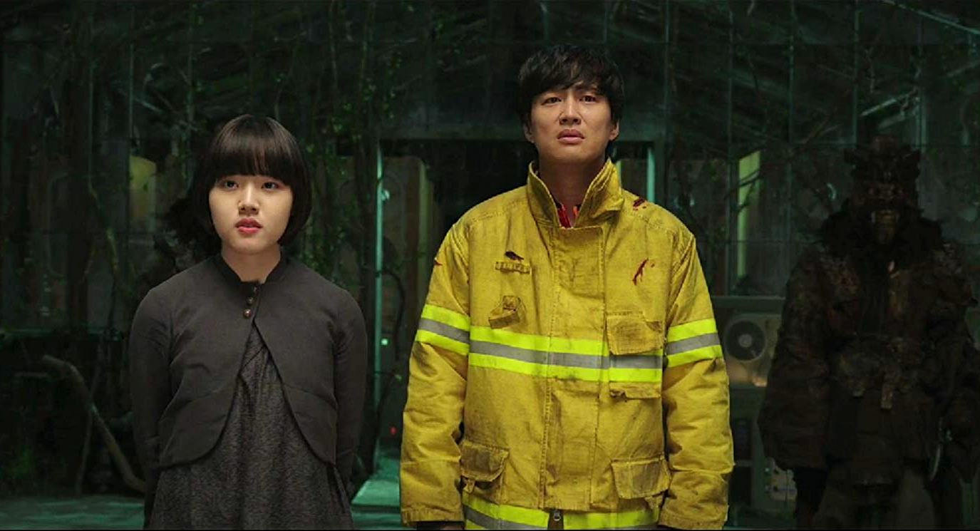 Firefighter Cha Tae-hyun guided through the afterlife by guardian Kim Hyang-gi in Along With the Gods: The Two Worlds (2017)
