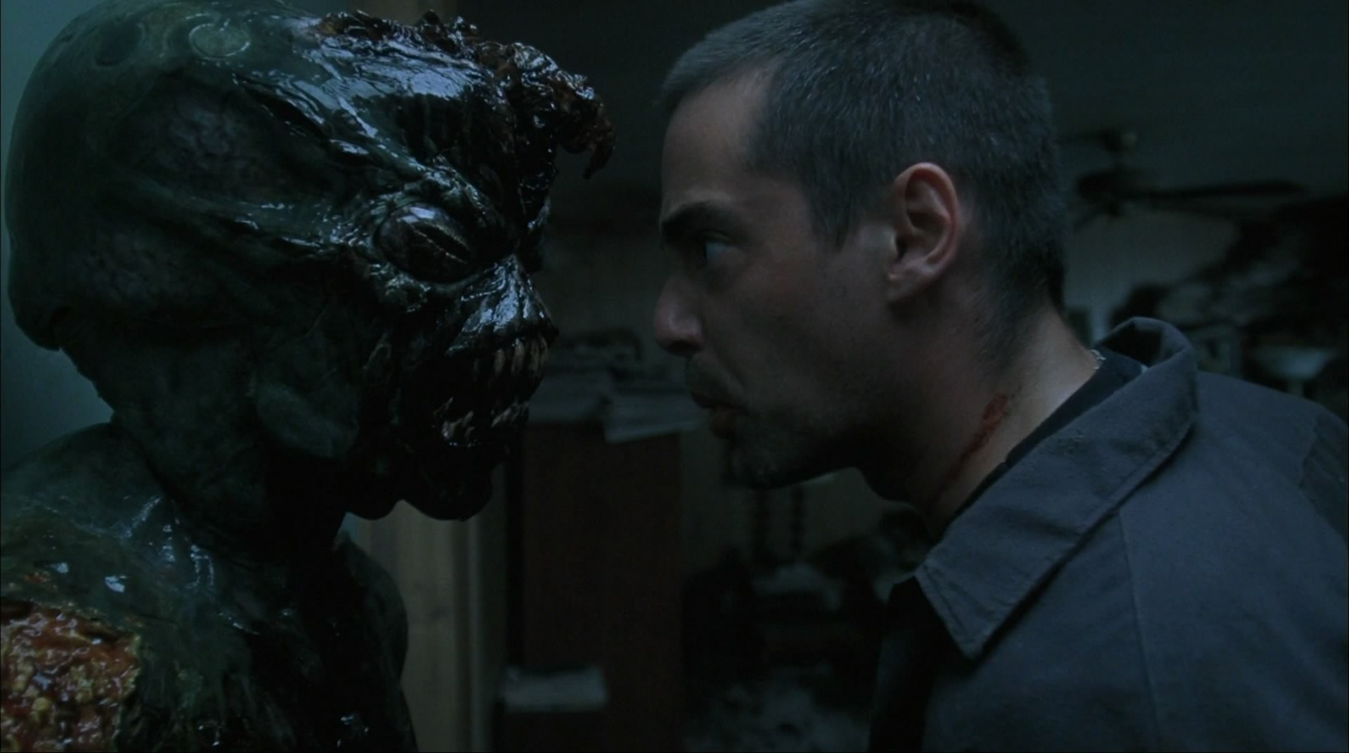 Adam Kaufman and the alien in Altered (2006)