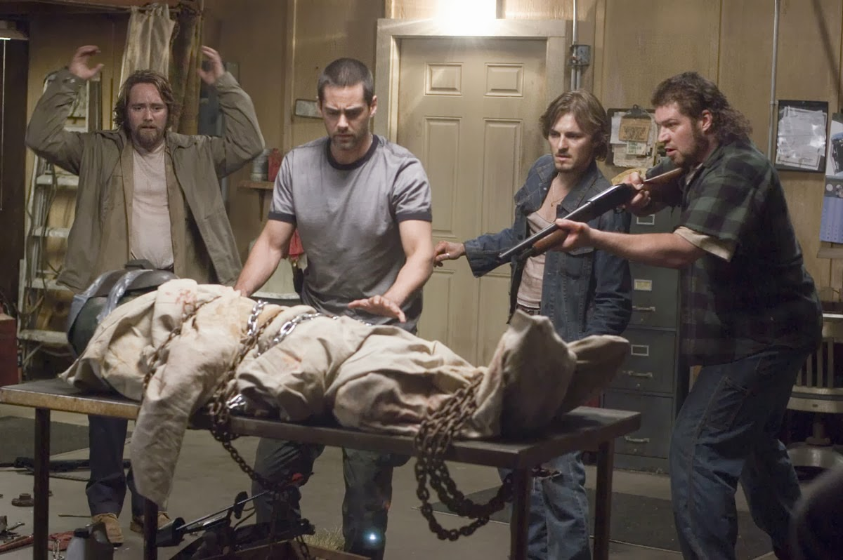 Four friends with a captured alien in their garage - (l to r) Paul McCarthy-Boyington, Adam Kaufman, Mike C. Williams and Brad William Henke in Altered (2006)