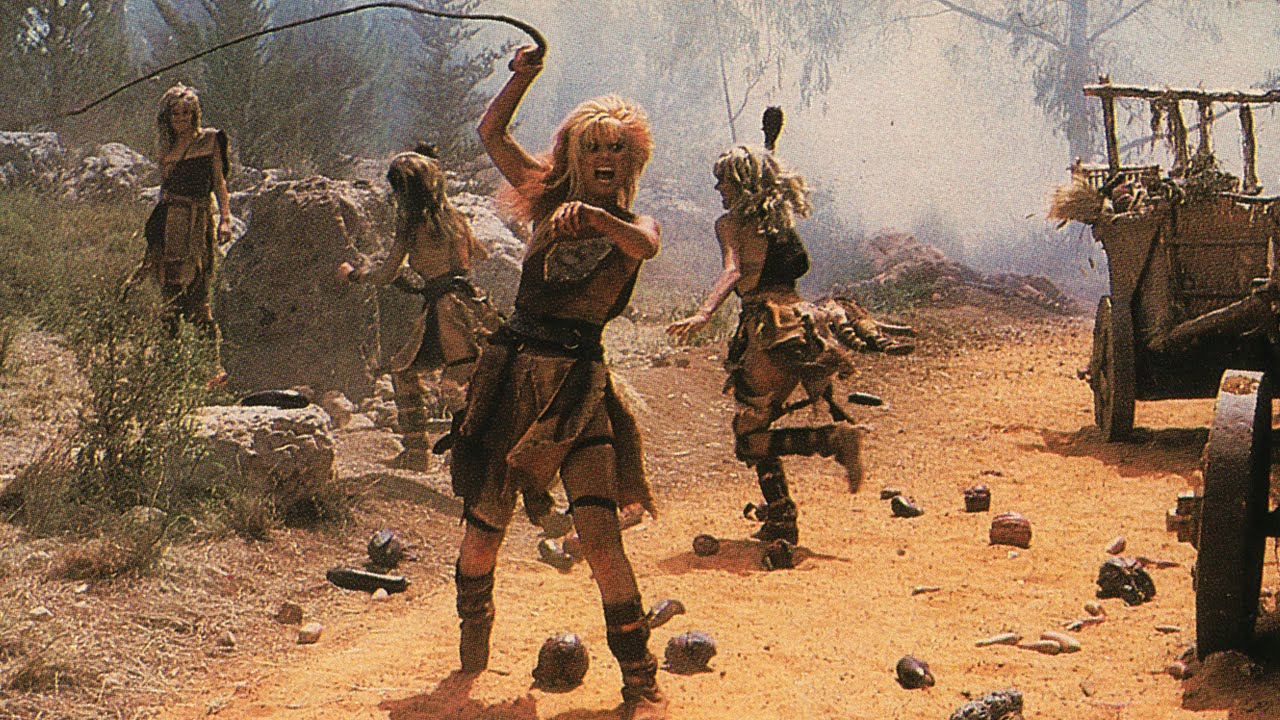 A whip-wielding Laurene Landon in America 3000 (1986)