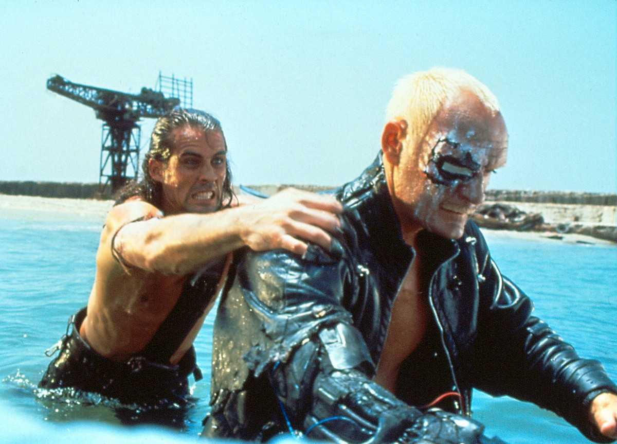 (l to r) Austin (Joe Lara) battles the killer cyborg (John P. Ryan) in American Cyborg: Steel Warrior (1992)