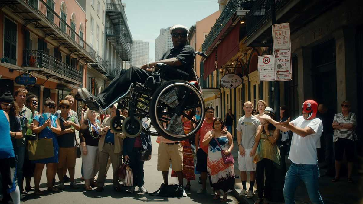 Stephen Dorff (r in red mask) levitates wheelchair-ridden best friend Eddie Griffin) in American Hero (2015)