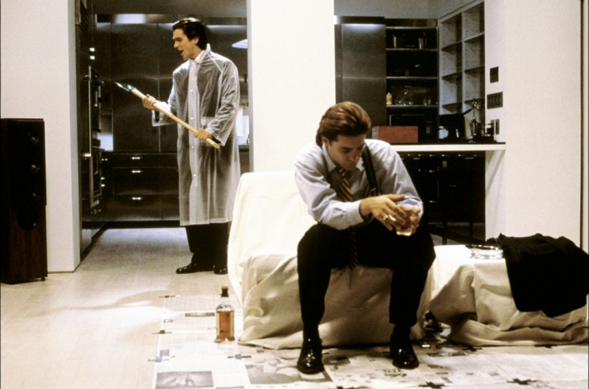 (l to r) Christian Bale prepares to dispatch Jared Leto with an axe in American Psycho (2000)