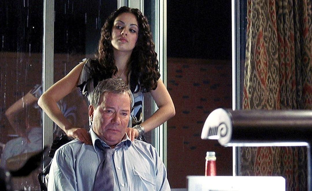 Mila Kunis offers a backrub to her professor William Shatner in American Psycho II: All American Girl (2002)
