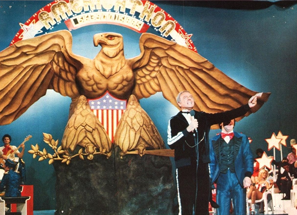 Monty Rushmore (Harvey Korman), host of the telethon to save America from bankruptcy in Americathon (1979)