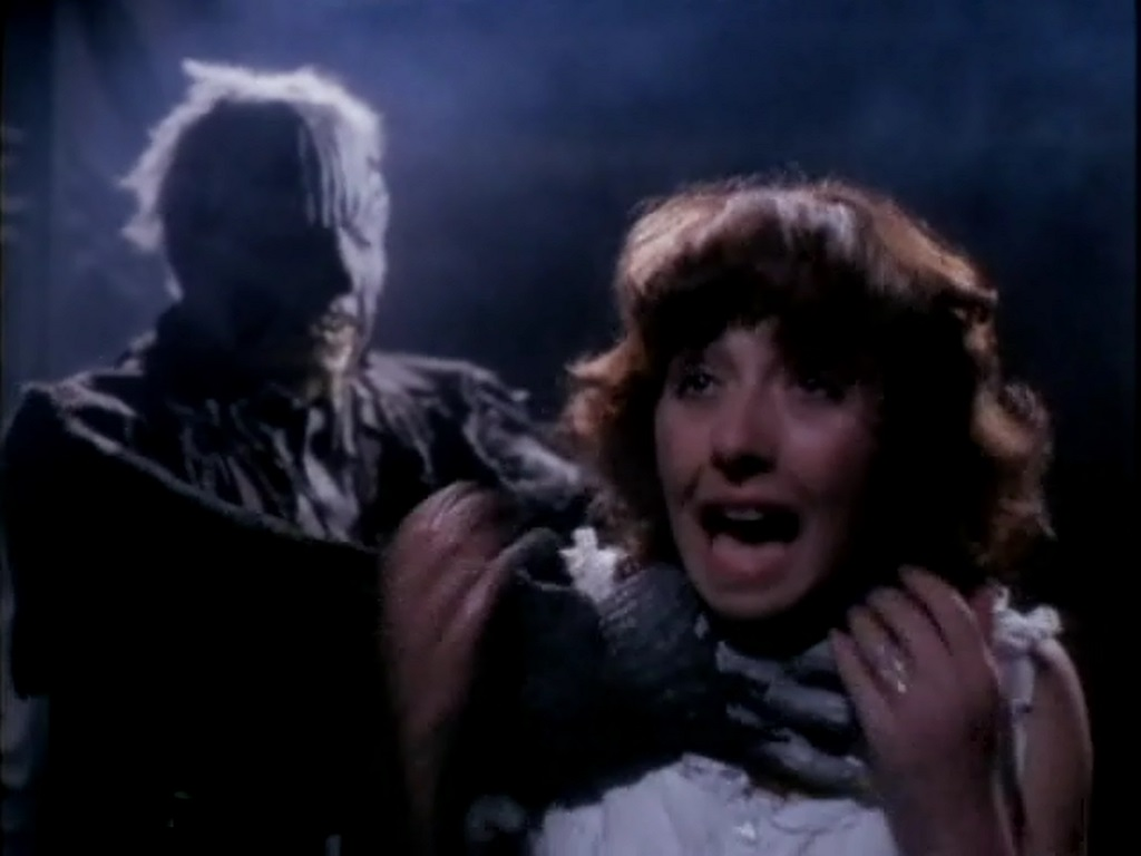 Dawna Wightman menaced by the figure lurking in the house in The Amityville Curse (1989)