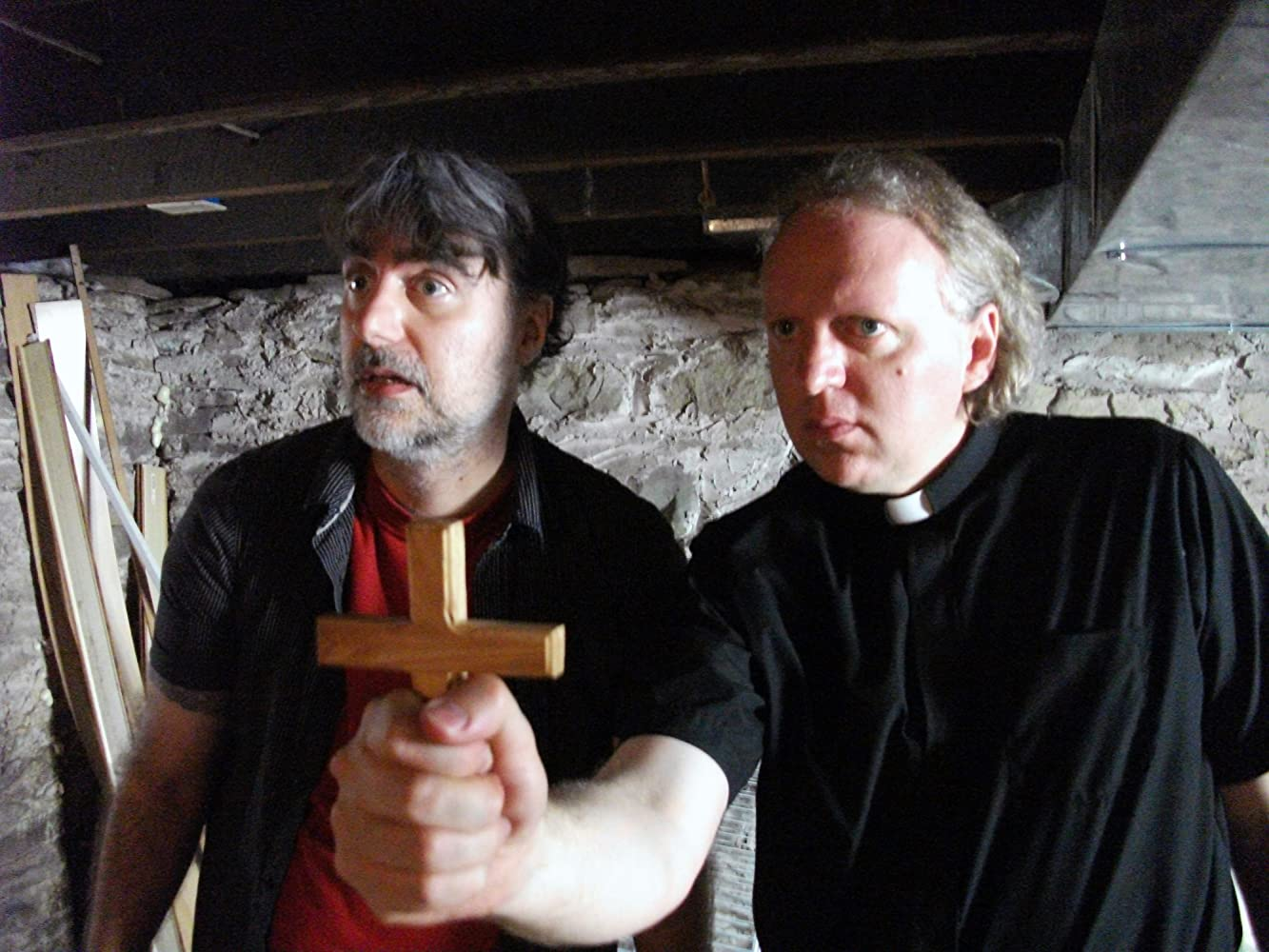 (l to r) James Carolus and priest Jeff Kirkendall perform an exorcism in Amityville Exorcism (2017)