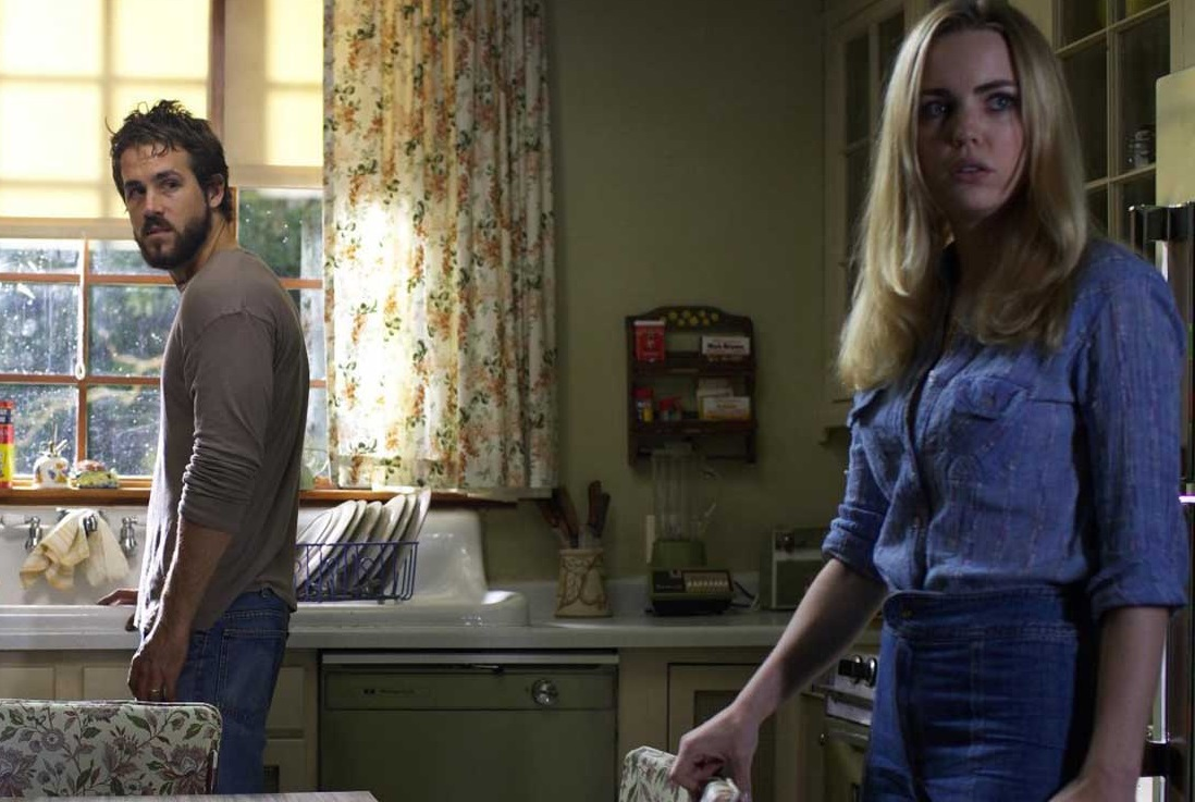 George and Kathy Lutz (Ryan Reynolds, Melissa George) in The Amityville Horror (2005)