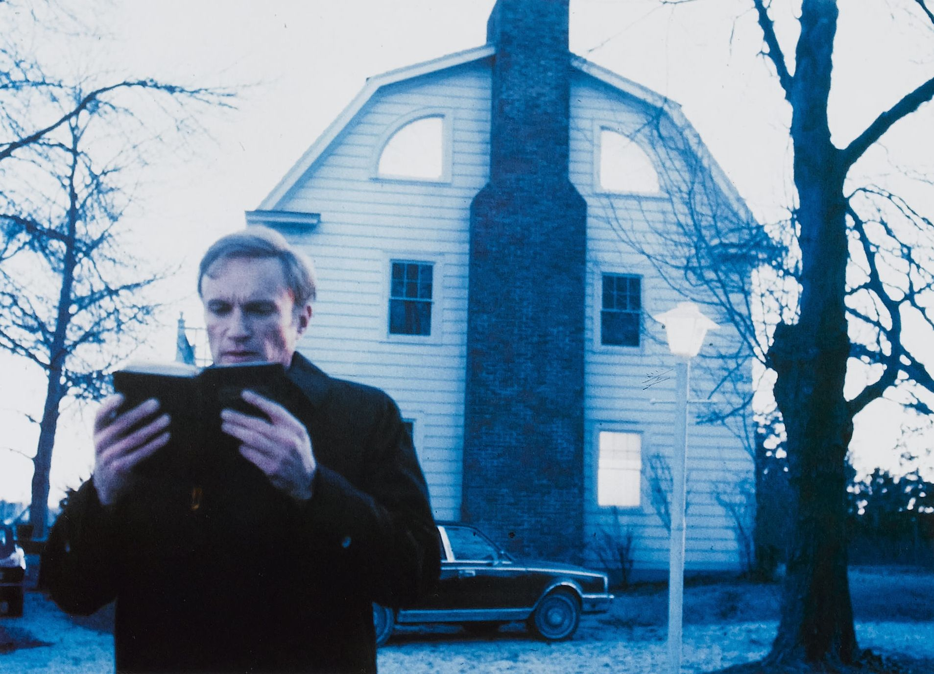 Priest James Olson prepares to sort out the Amityville house in Amityville II The Possession (1982)