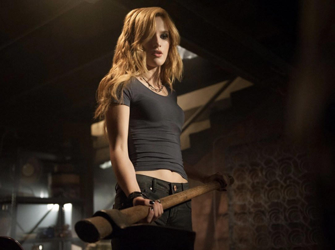 Bella Thorne wields an axe in Amityville: The Awakening (2017)