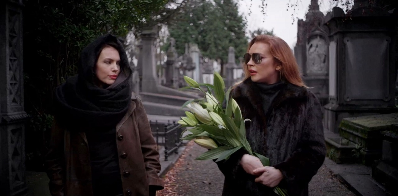 Werewolf private detective Katie Wolfe (Charlotte Beckett) and Patricia Sherman (Lindsay Lohan), wife of the President of the European Federation in Among the Shadows (2019)