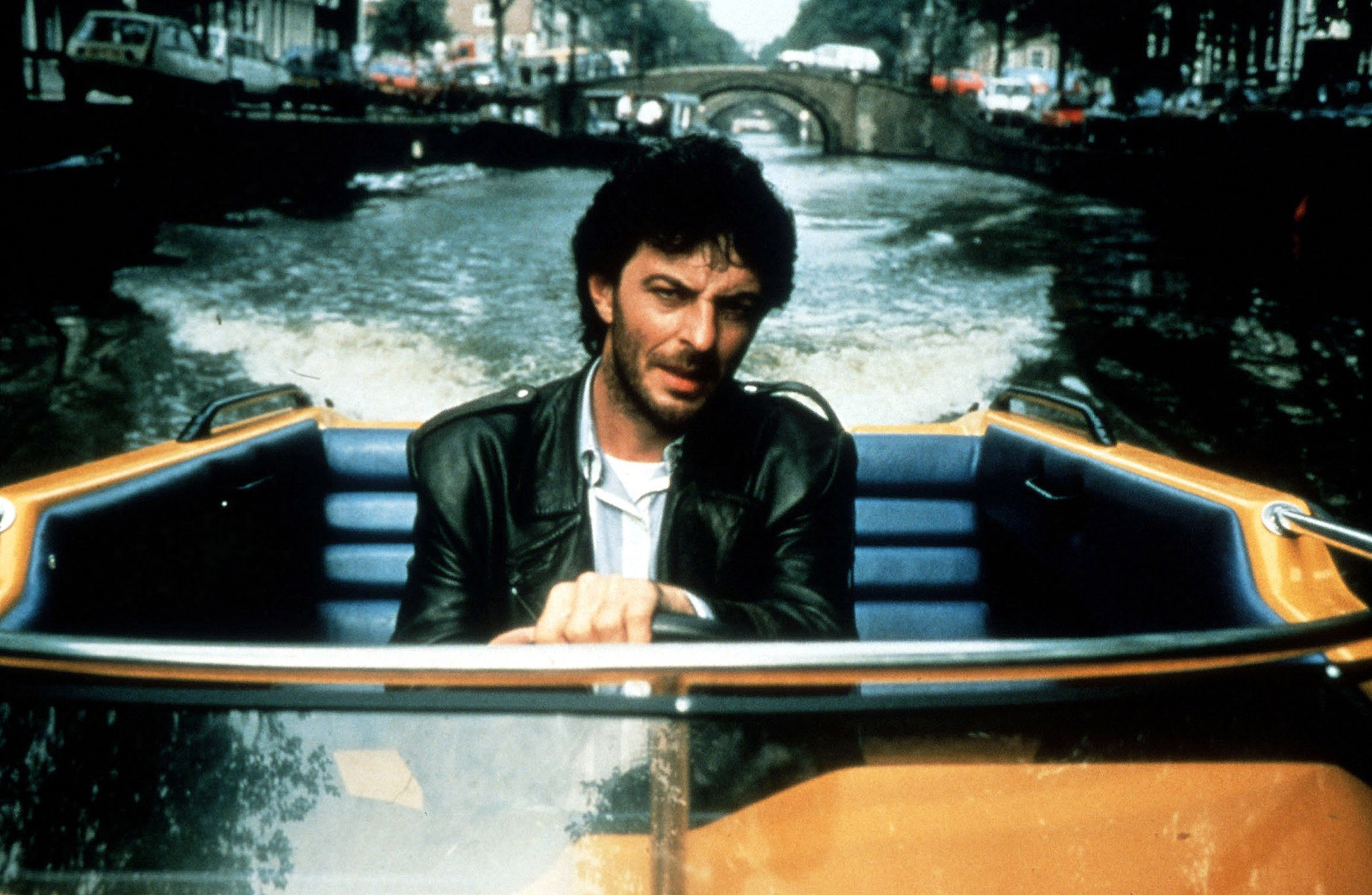 Detective hero Huub Stapel in the film's standout speedboat chase sequence in Amsterdamned (1988)