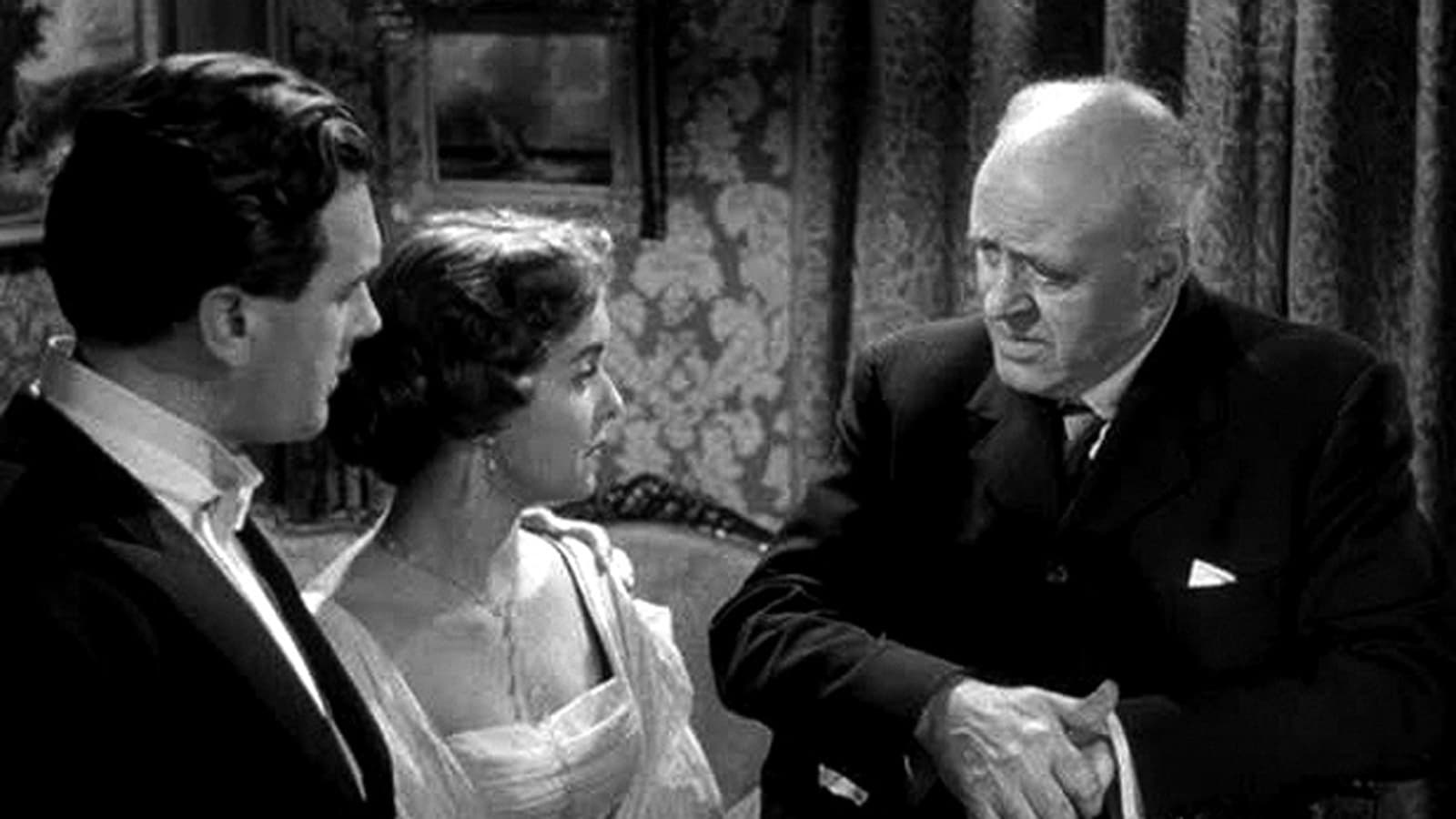 The Inspector (Alistair Sim) questions Brian Worth and Eileen Moore in An Inspector Calls (1954)