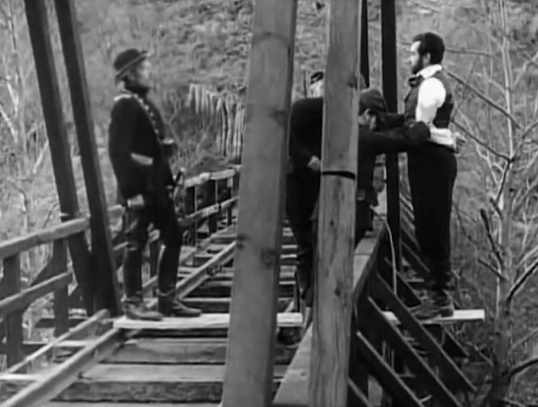Confederate soldiers prepare to hang Roger Jacquet from bridge in An Occurrence at Owl Creek Bridge (1961) poster