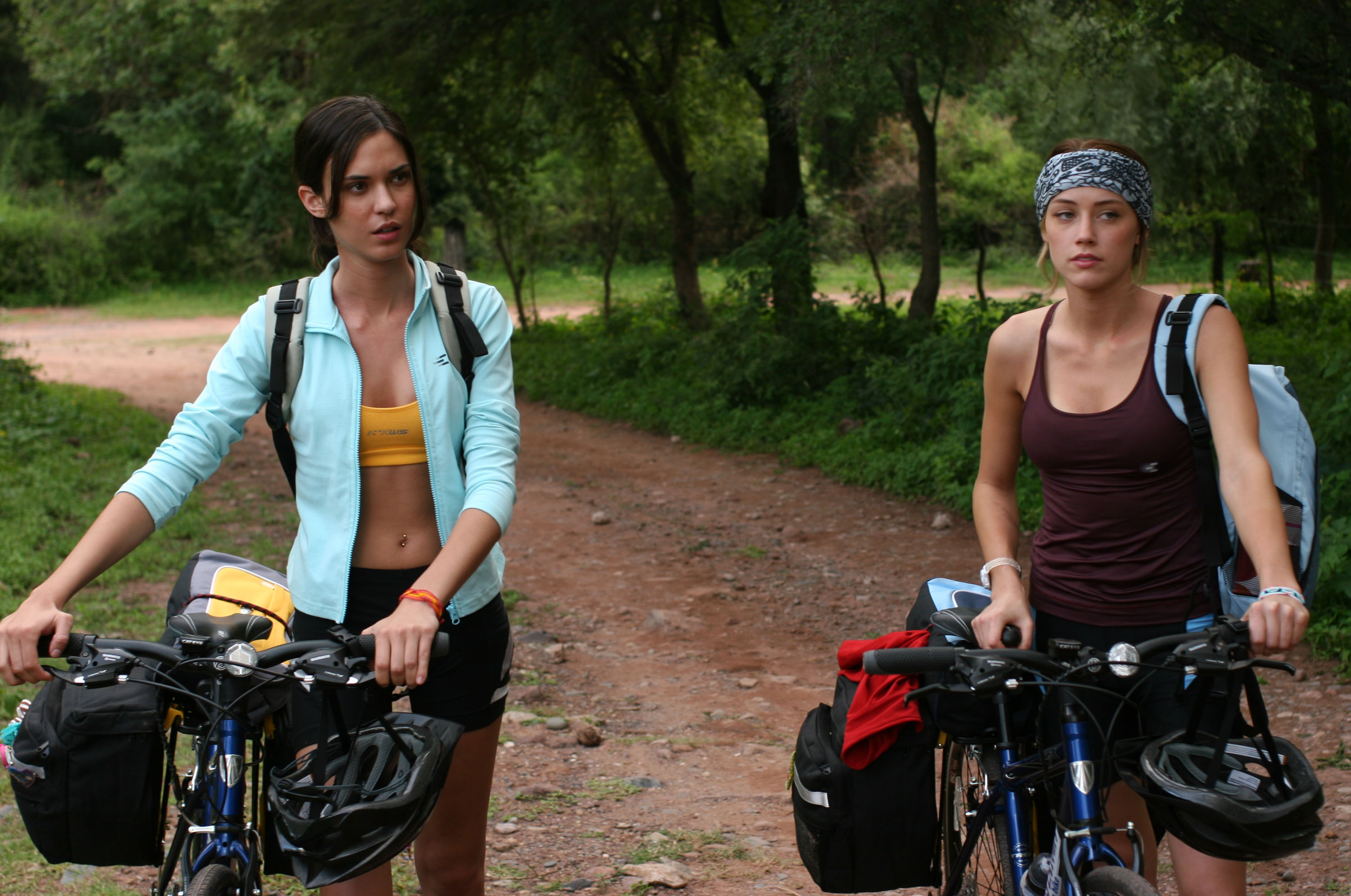 Odette Yustman and Amber Heard - two girls on a cycling tour of Argentina in And Soon the Darkness (2010)