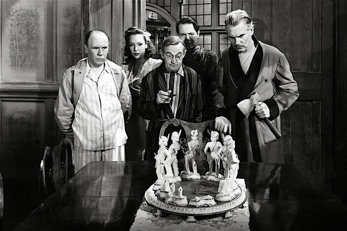 Roland Young, June Duprez, Barry Fitzgerald, Louis Hayward and Walter Huston with the Ten Little Indians in And Then There Were None (1945)
