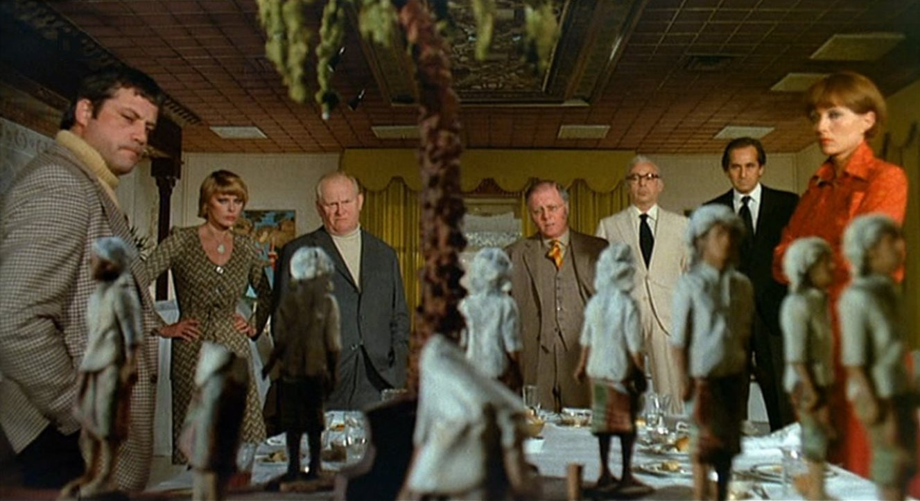 The gathered guests - (l to r) Oliver Reed, Elke Sommer, Gert Frobe, Richard Attenborough, Herbert Lom, Alberto de Mendoza, Stephane Audran in And Then There Were None (1974)