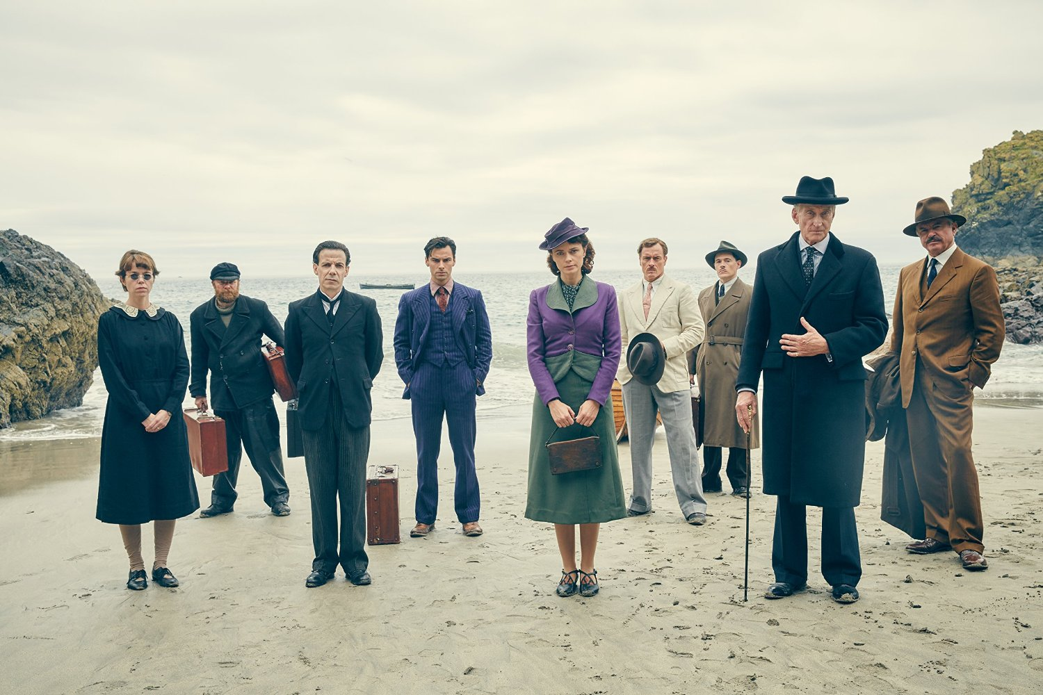 The characters arrive on the island - (l to r) Anna Maxwell Martin, Christopher Hatherall, Noah Taylor, Aidan Turner, Maeve Dermody, Toby Stephens, Burn Gorman, Charles Dance, Sam Neill in And Then There Were None (2015)