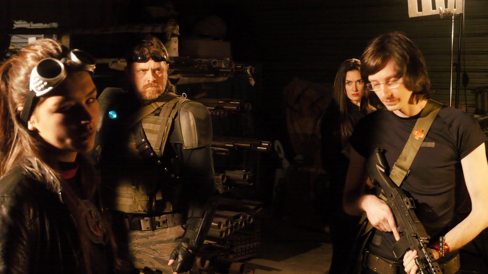 The mercenaries prepare to enter the facility - (l to r) Juanita Arias, Joe Chapman, Virginia Logan and Nat Cassidy in Android Insurrection (2012)