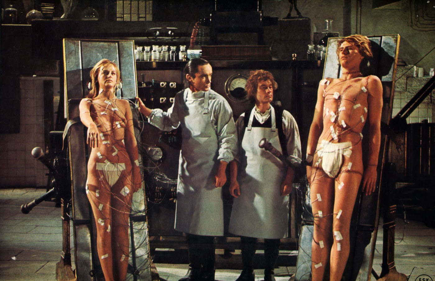 Baron Frankenstein (Udo Kier) with assistant Otto (Arno Juerging) flanked by his female (Dalila Di Lazzaro) and male (Srdjan Zelenovic) creations in Andy Warhol's Frankenstein (1973)