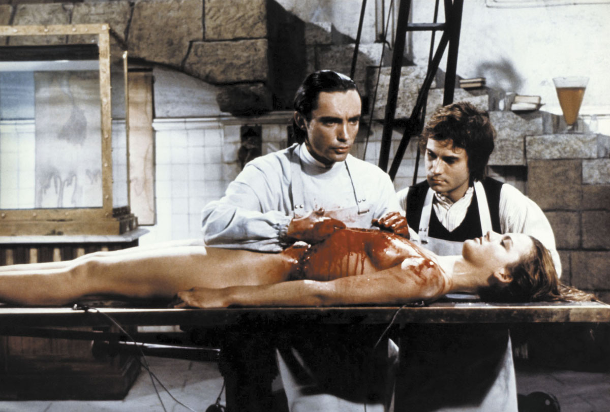 (l to r) Baron Frankenstein (Udo Kier) and assistant Otto (Arno Juerging) at work on the corpse of Dalila Di Lazzaro in Andy Warhol's Frankenstein (1973)
