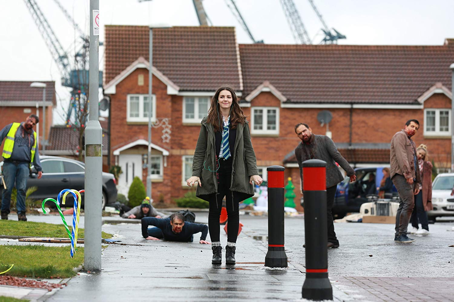 Anna (Ella Hunt) sets off on her school day unnoticing of the zombie apocalypse around her in Anna and the Apocalypse (2017)
