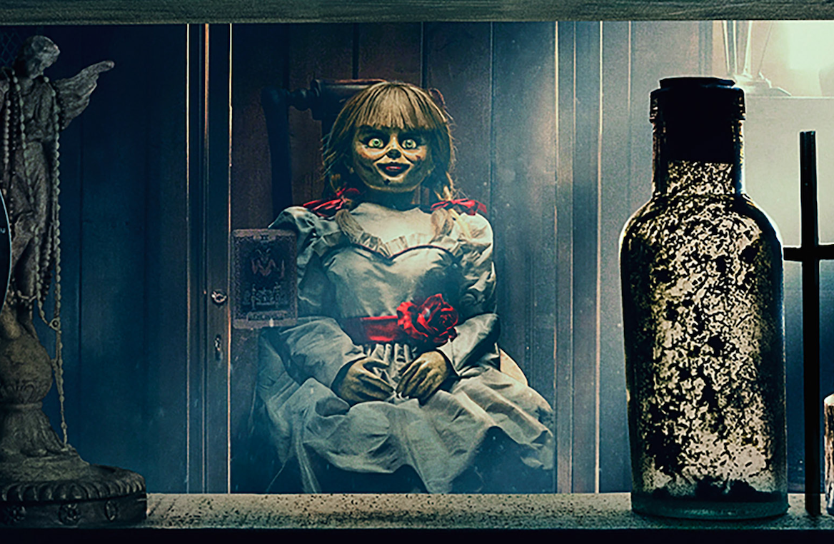 The Annabelle doll in her cabinet in the Warren's museum in Annabelle Comes Home (2019)