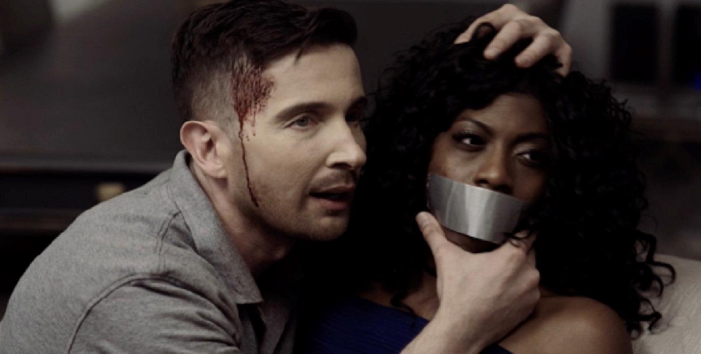 Jason (Daniel DeWeldon) threatens Jessica Boss in Anonymous 616 (2018)