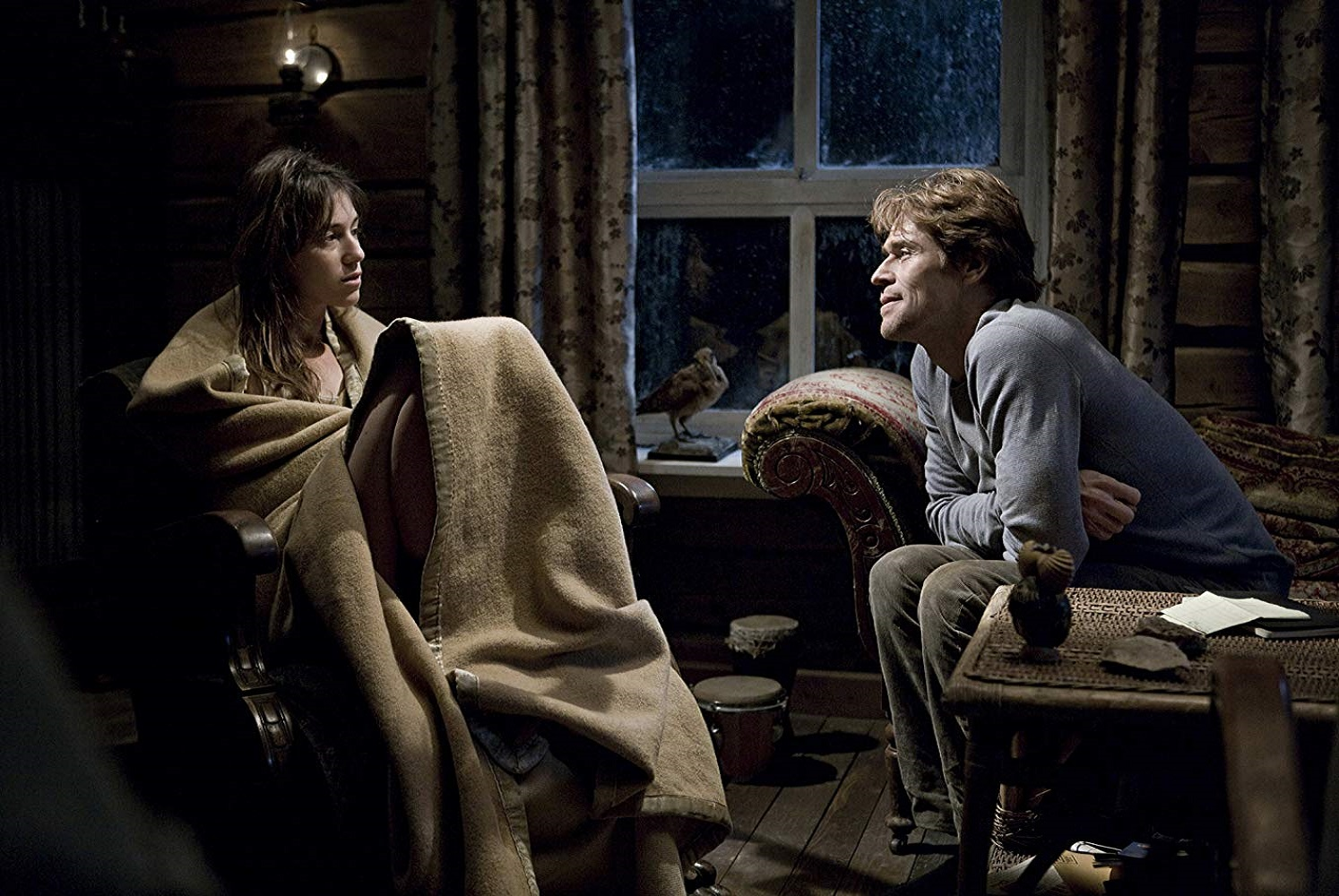 Willem Dafoe tries to console disturbed wife Charlotte Gainsbourg in Antichrist (2009)