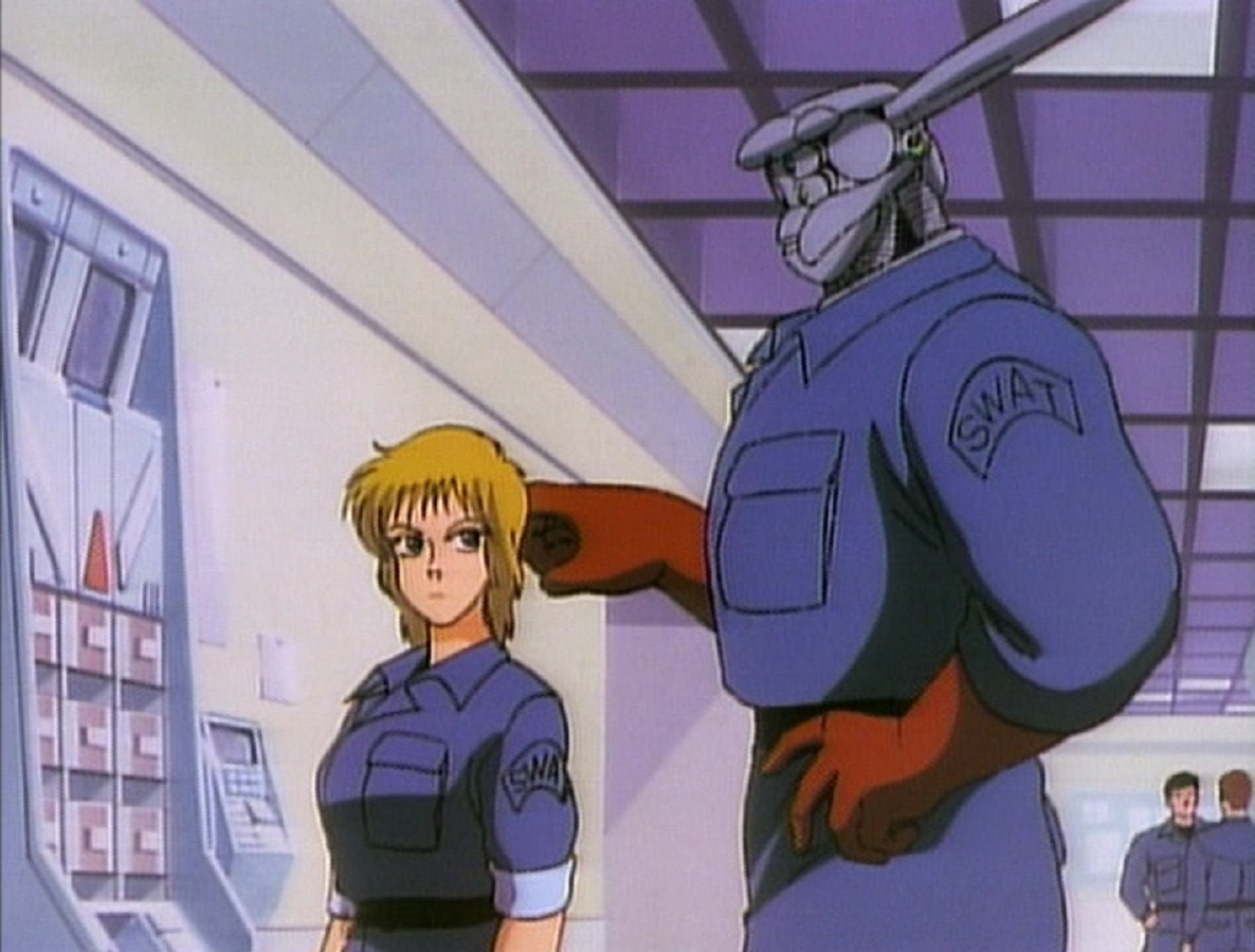SWAT officers Nan Doonan and her cyborg partner Briareos in Appleseed (1988)