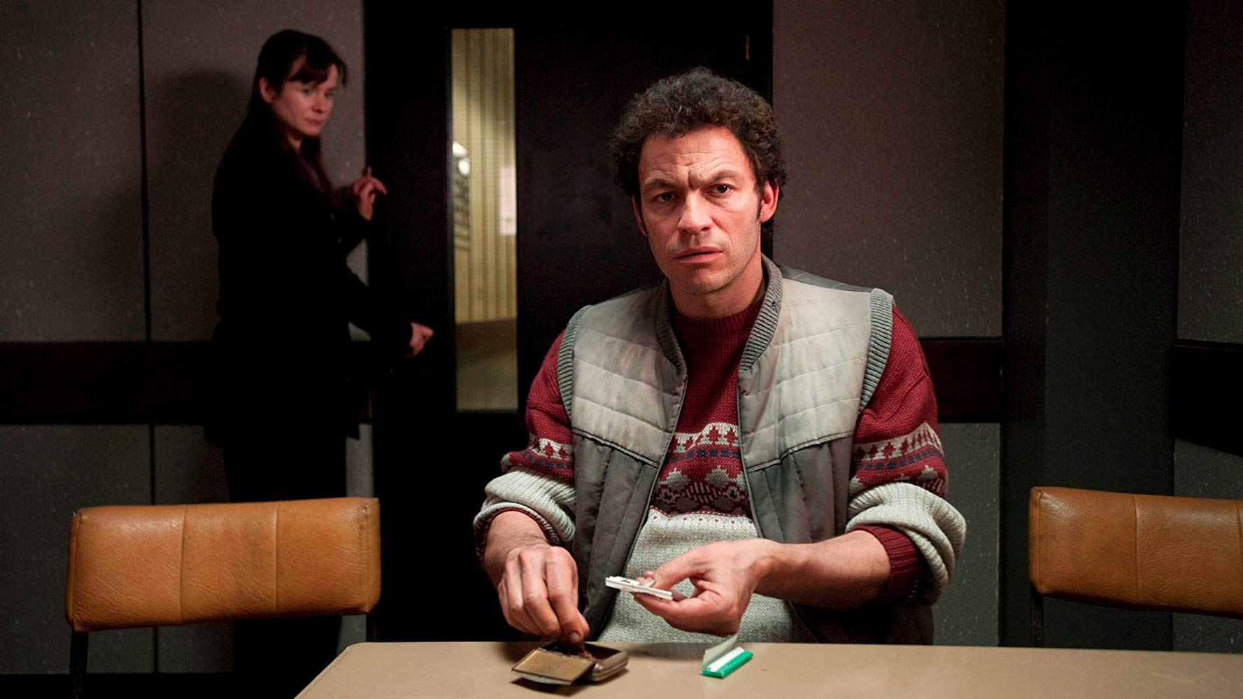 Dominic West as serial killer Fred West with Emily Watson in the background in Appropriate Adult (2011)