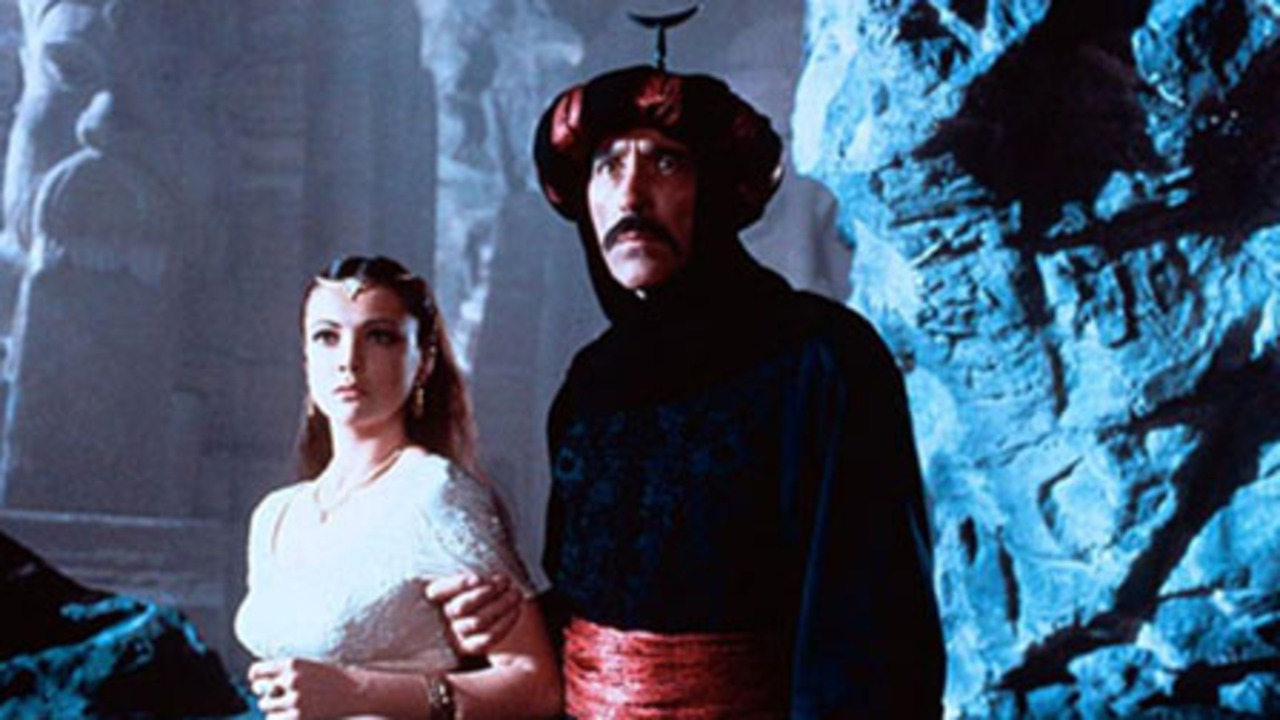 The Princess Zuliera (Emma Samms) is held prisoner by the evil Caliph Alquazar (Christopher Lee) in Arabian Adventure (1979)