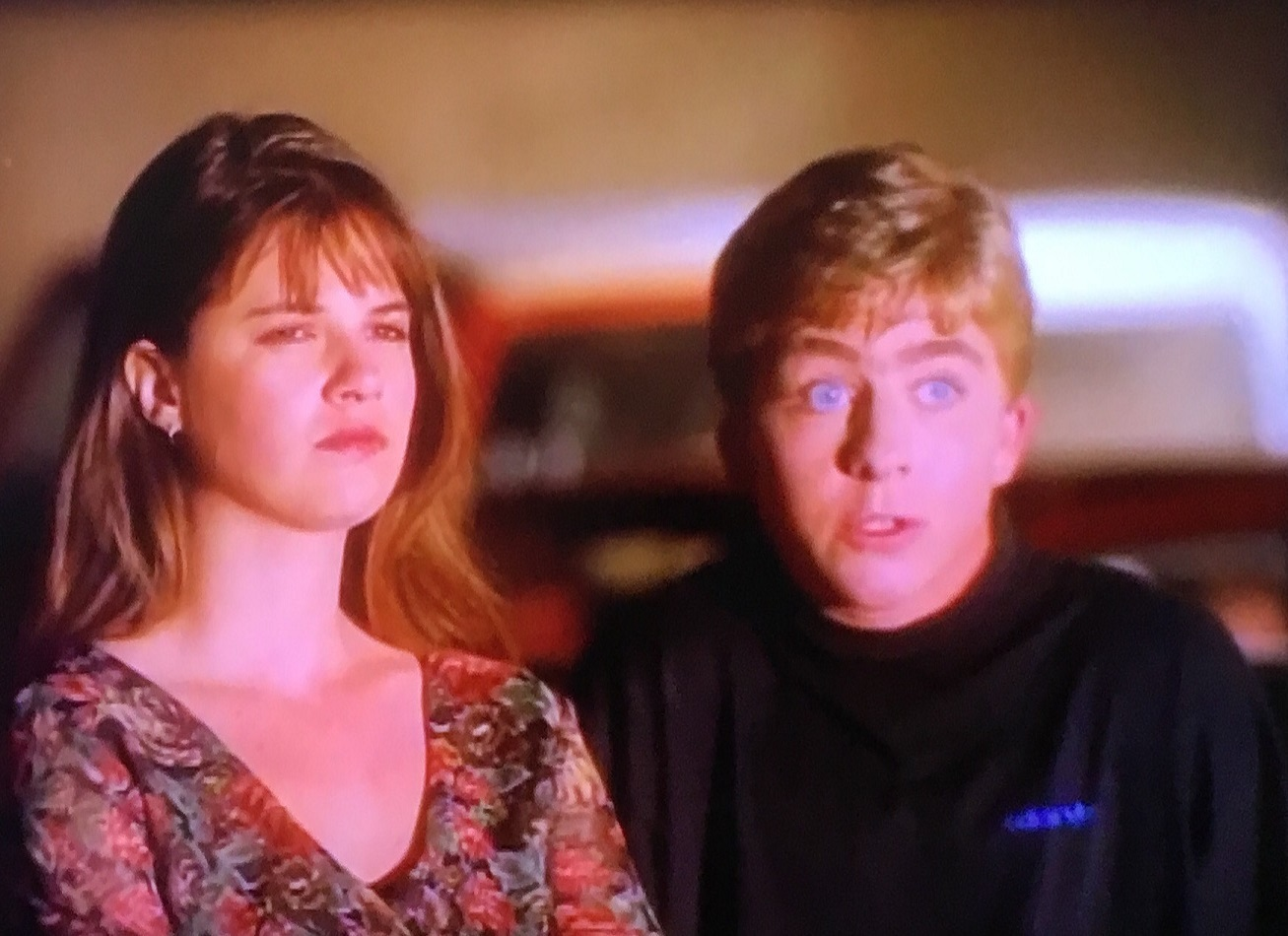 Megan Ward, Peter Billiingsley in Arcade (1994)