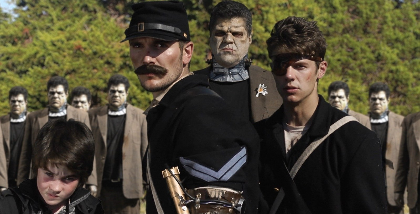 (l to r) Igor (Christian Bellgardt), Corporal Solomon Jones (Rett Terrell), the Frankenstein Monster (Eric Gesecus) and time traveler Alan Jones (Jordan Farris) in Army of Frankensteins (2014)