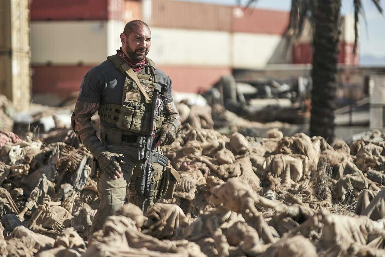 Dave Bautista amid the zombie dead in the ruins of Las Vegas in Army of the Dead (2021)