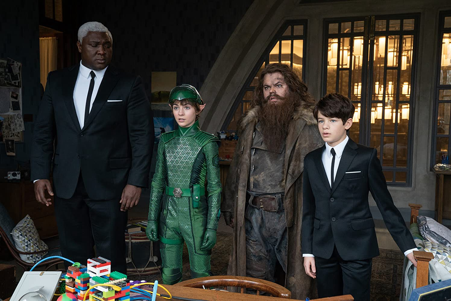 Domovol Butler (Nonso Anozie), the fairy Holly Short (Lara McDonnell), the giant dwarf Mitch Diggums (Josh Gad) and Artemis Fowl (Ferdia Shaw) in Artemis Fowl (2020)