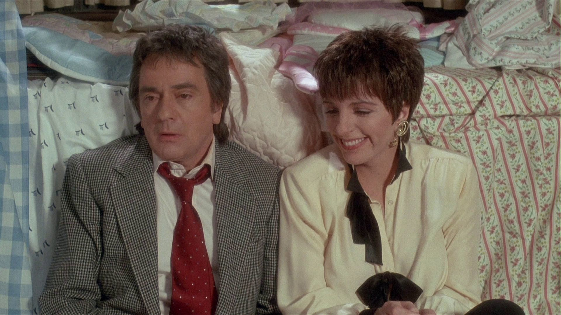 Millionaire Arthur (Dudley Moore) and his wife Liza Minelli find themselves down on their luck in Arthur 2: On the Rocks (1988)