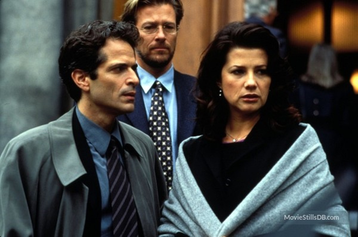 Stewart Bick (l) with accused Daphne Zuniga (r) in Artificial Lies (1999)