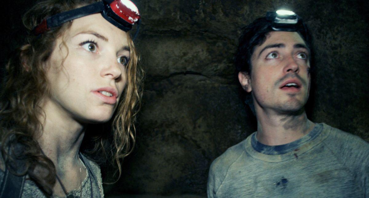Perdita Weeks and Ben Feldman go exploring the catacombs beneath the streets of Paris in As Above, So Below (2014)