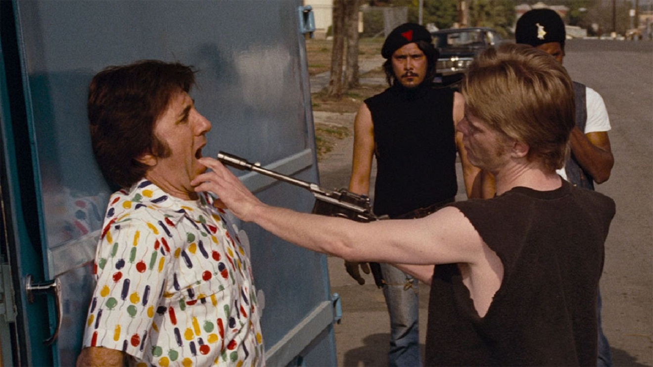 The gang members terrorise a family at an ice cream truck in Assault on Precinct 13 (1976)