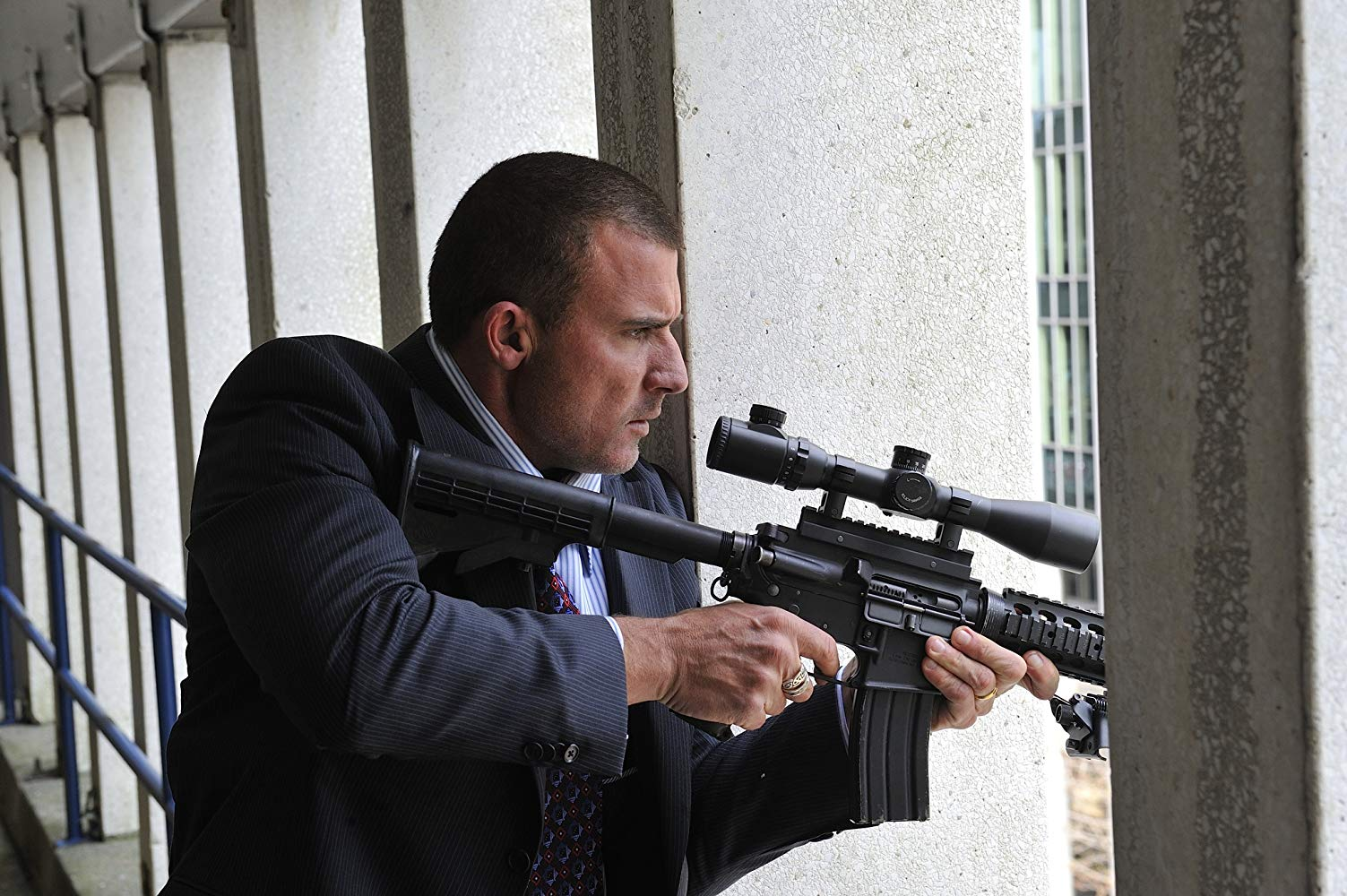 Dominic Purcell goes on a shooting rampage against bankers in Assault on Wall Street (2013)