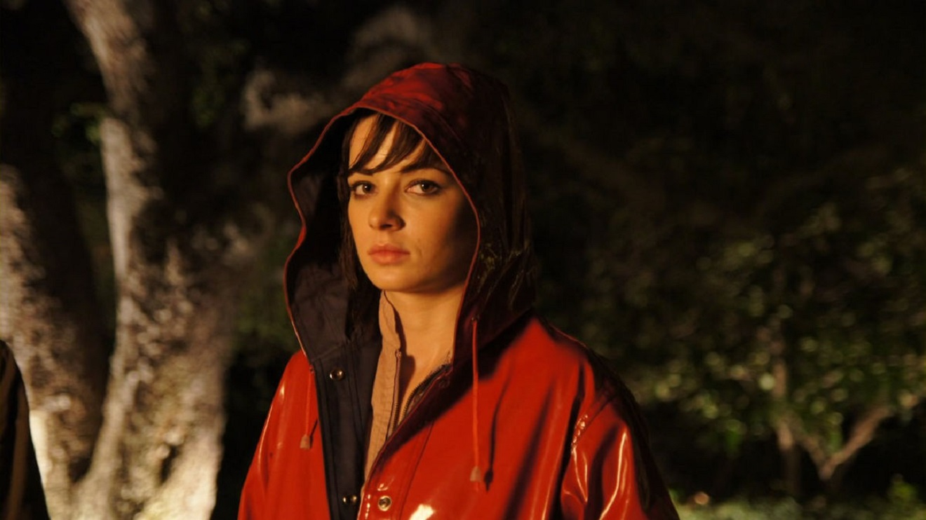 The red-raincoated Hannah (Ashley Rickards0 in At the Devil's Door (2014)