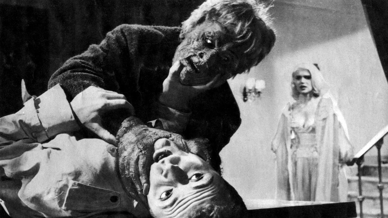 The transformed Alberto Lupo strangles a victim as Susanne Loret looks on in Atom Age Vampire (1960)